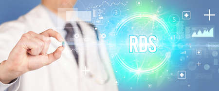 Close-up of a doctor giving you a pill with RDS abbreviation, virology concept