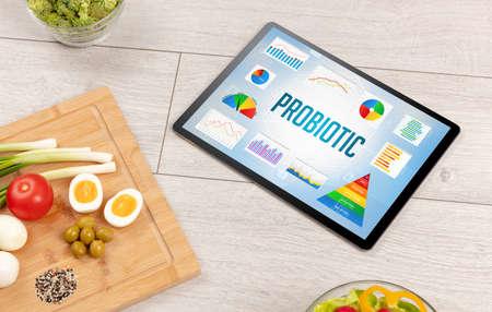 Organic food and tablet pc showing PROBIOTIC inscription, healthy nutrition composition Reklamní fotografie