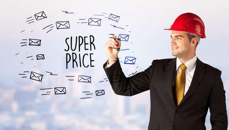 Handsome businessman with helmet drawing SUPER PRICE inscription, contruction sale concept