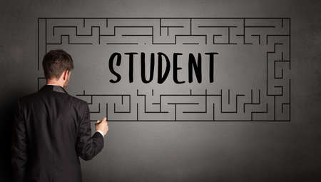 businessman drawing maze with STUDENT inscription, business education concept