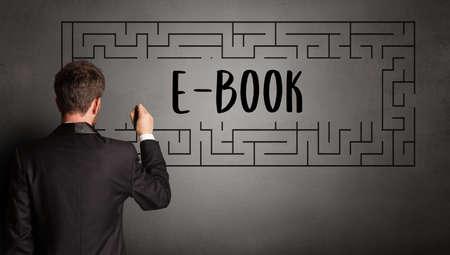 businessman drawing maze with E-BOOK inscription, business education concept 版權商用圖片