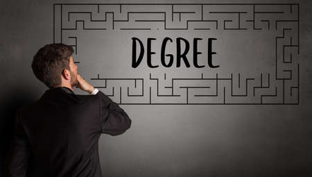 businessman drawing maze with DEGREE inscription, business education concept