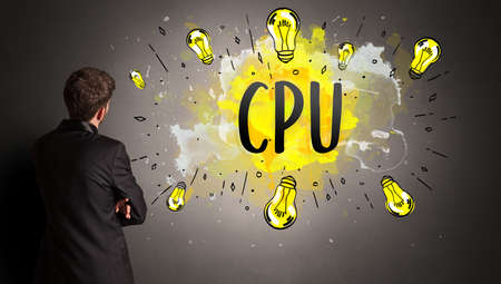 businessman drawing colorful light bulb with CPU abbreviation, new technology idea concept