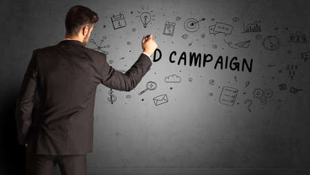 businessman drawing a creative idea sketch with AD CAMPAIGN inscription, business strategy concept