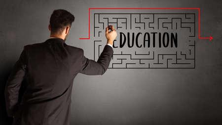 businessman drawing maze with EDUCATION inscription, business education concept 版權商用圖片