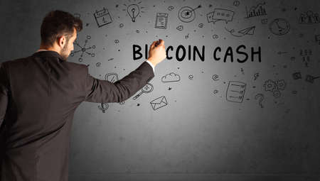 businessman drawing a creative idea sketch with BITCOIN CASH inscription, business strategy concept