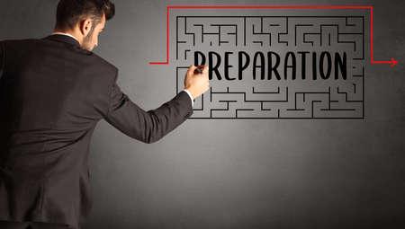 businessman drawing maze with PREPARATION inscription, business education concept 版權商用圖片
