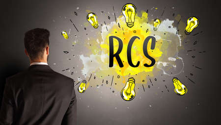 businessman drawing colorful light bulb with RCS abbreviation, new technology idea concept Stock fotó