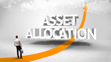 Rear view of a businessman standing in front of ASSET ALLOCATION inscription, successful business concept
