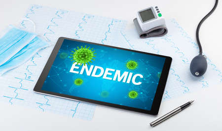 Close-up view of a tablet pc with ENDEMIC inscription, microbiology concept