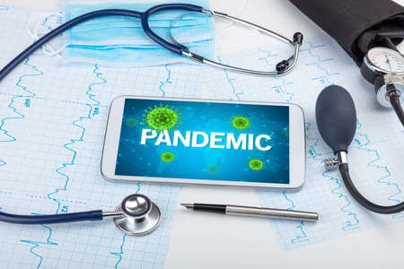 Close-up view of a tablet pc with PANDEMIC inscription, microbiology concept