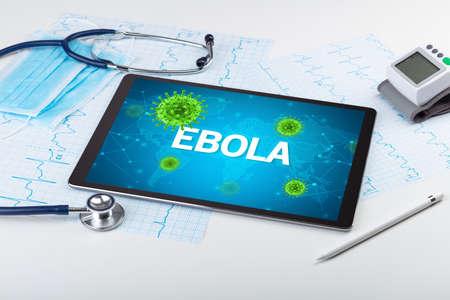 Close-up view of a tablet pc with EBOLA inscription, microbiology concept Reklamní fotografie