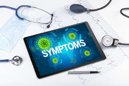Close-up view of a tablet pc with SYMPTOMS inscription, microbiology concept