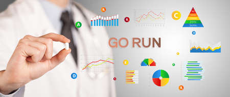 Nutritionist giving you a pill with GO RUN inscription, healthy lifestyle concept