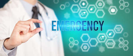 Close-up of a doctor giving you a pill with EMERGENCY inscription, medical concept