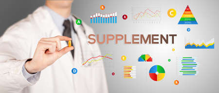 Nutritionist giving you a pill with SUPPLEMENT inscription, healthy lifestyle concept
