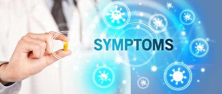 Doctor giving pill with SYMPTOMS inscription, coronavirus concept