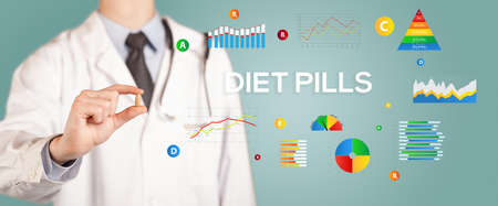 Nutritionist giving you a pill with DIET PILLS inscription, healthy lifestyle concept