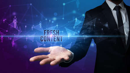 Elegant hand holding FRESH CONTENT inscription, social networking concept 版權商用圖片