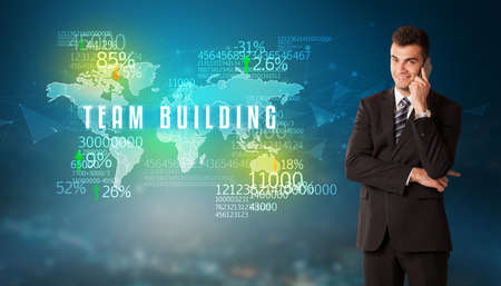 Businessman in front of a decision with TEAM BUILDING inscription, business concept