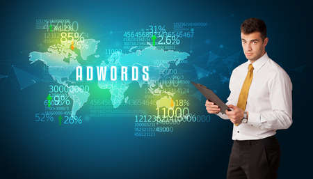 Businessman in front of a decision with ADWORDS inscription, business concept