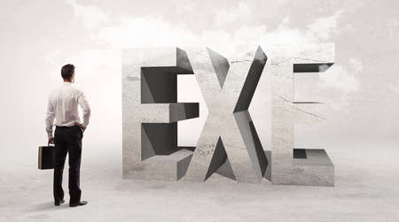 Rear view of a businessman standing in front of EXE abbreviation, attention making concept