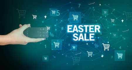 hand holding wireless peripheral with EASTER SALE inscription, online shopping concept