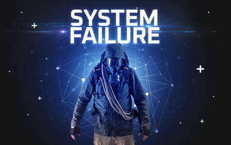 Mysterious hacker with SYSTEM FAILURE inscription, online attack concept inscription, online security concept