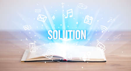 Opeen book with SOLUTION inscription, business concept