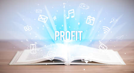 Opeen book with PROFIT inscription, business concept