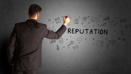 businessman drawing a creative idea sketch with REPUTATION inscription, business strategy concept