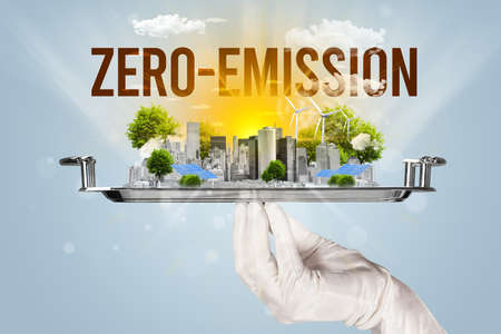 Waiter serving eco city with ZERO-EMISSION inscription, renewabke energy concept Imagens