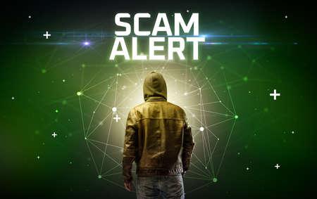 Mysterious hacker with SCAM ALERT inscription, online attack concept inscription, online security concept