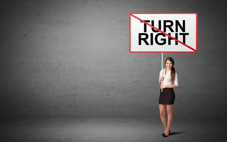 business person holding a traffic sign with TURN RIGHT inscription, new idea concept