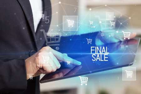 Young person makes a purchase through online shopping application with FINAL SALE inscription