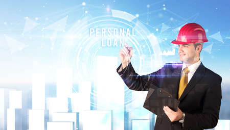 Handsome businessman with helmet drawing PERSONAL LOAN inscription, contruction business concept
