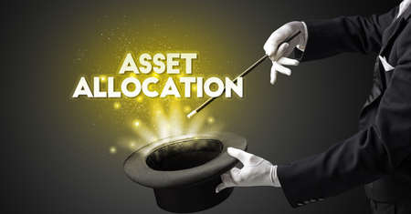 Illusionist is showing magic trick with ASSET ALLOCATION inscription, new business model concept Фото со стока