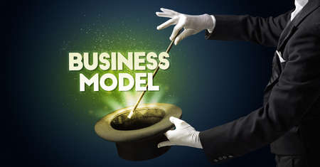 Illusionist is showing magic trick with BUSINESS MODEL inscription, new business model concept
