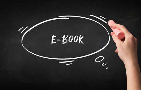 Hand drawing E-BOOK inscription with white chalk on blackboard, education concept 版權商用圖片