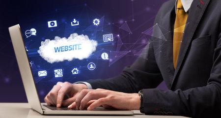 Businessman working on laptop with WEBSITE inscription, modern technology concept Banque d'images