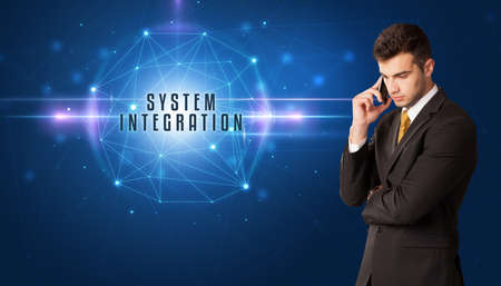 Businessman thinking about security solutions with SYSTEM INTEGRATION inscription