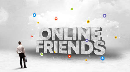 Young businessman standing in front of ONLINE FRIENDS inscription, social media concept