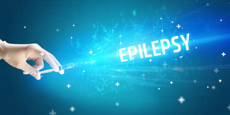 Syringe, medical injection in hand with EPILEPSY inscription, medical antidote concept