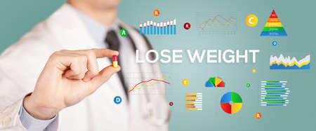Nutritionist giving you a pill with LOSE WEIGHT inscription, healthy lifestyle concept