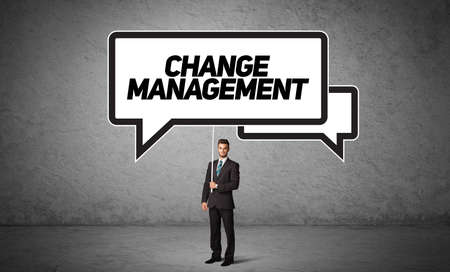 Young business person in casual holding road sign with CHANGE MANAGEMENT inscription, new business idea concept