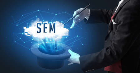 Magician is showing magic trick with SEM abbreviation, modern tech concept