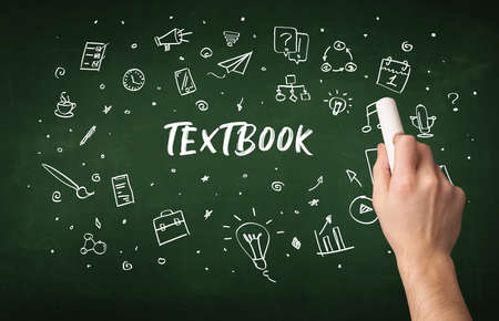 Hand drawing TEXTBOOK inscription with white chalk on blackboard, education concept