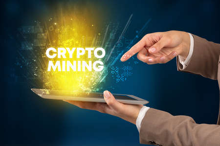 Close-up of a touchscreen with CRYPTO MINING inscription, innovative technology concept