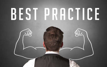 Rear view of a businessman with BEST PRACTICE inscription, powerfull business concept