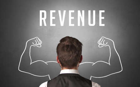 Rear view of a businessman with REVENUE inscription, powerfull business concept